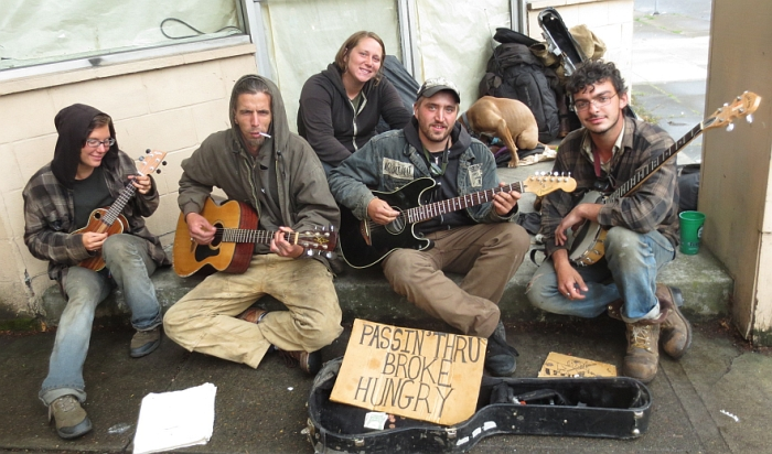 Homeless triblette of traveling musicians, Portland, Oregon. Photo taken by Julian Lee along his antifa sticker cleanup route.